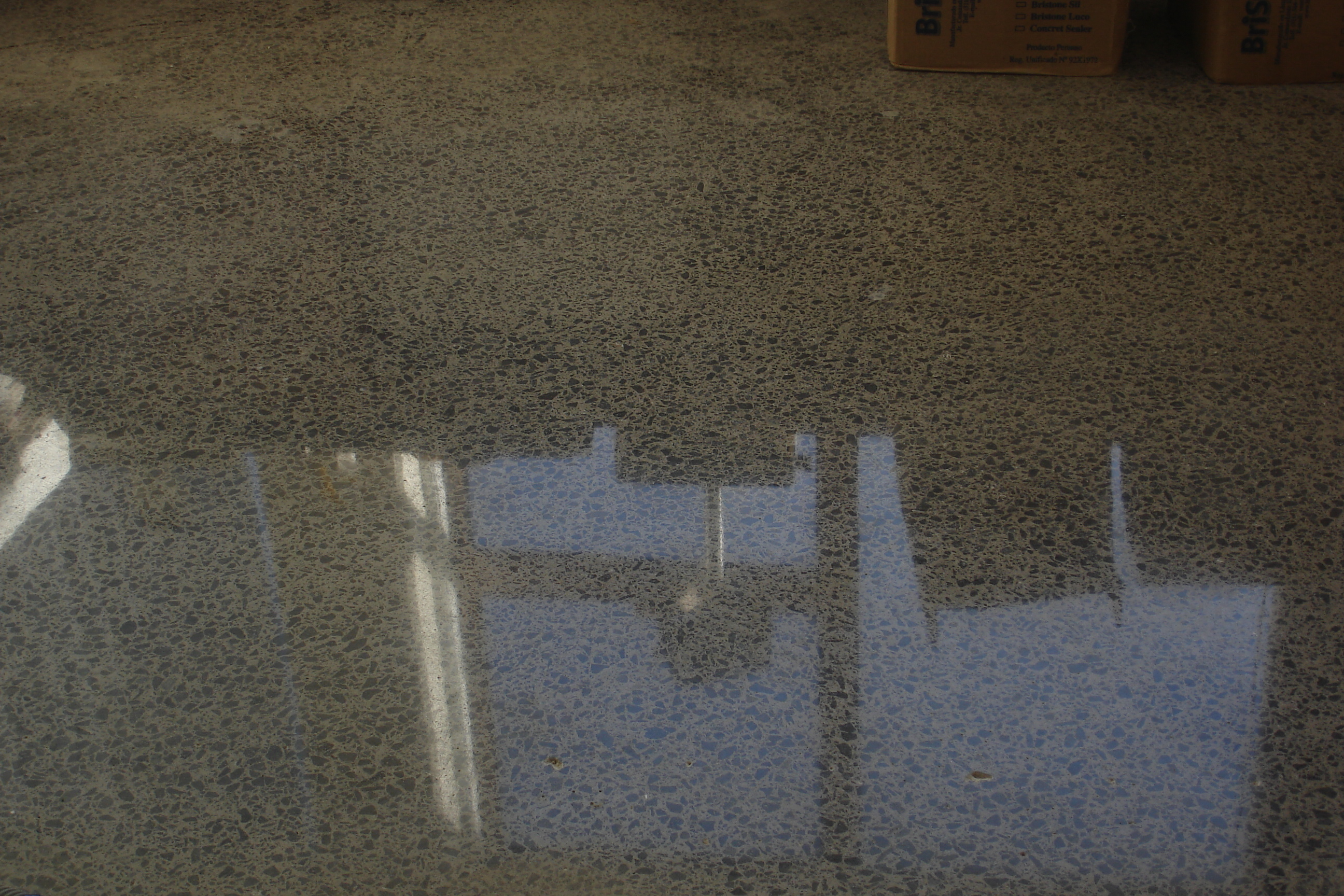 BriStone on honed and polished concrete, high traffic area and installed for over a year with no cleaning.